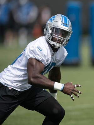 Lions rookie linebacker Jarrad Davis goes through drills during organized team activities Wednesday, May 31, 2017 at Allen Park.