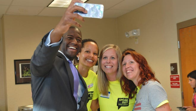 """Taking photos with members of Speak Out Brevard. Tallahassee Mayor Andrew Gillum, a Democrat who is running for Florida Governor, was one of the speakers at a  packed """"People's Town Hall"""", organized by Speak Out Brevard, held at Viera high school auditorium Tuesday evening."""