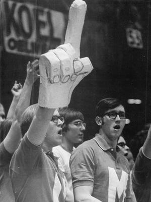 Steve Chmelar hoists his homemade finger at an Ottumwa (Iowa) high school basketball game in the early 1970s.