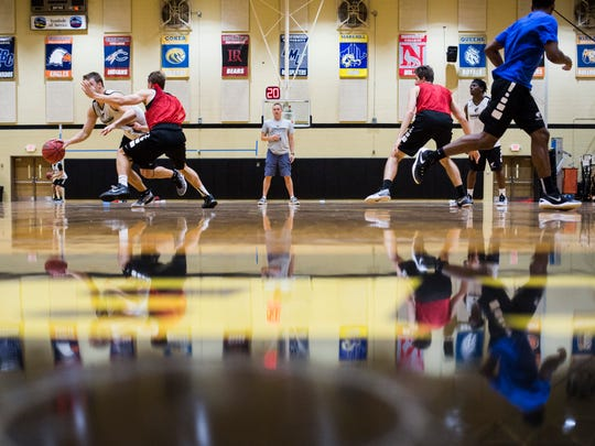 Anderson University's head basketball coach Jeff Brookman watches as his players work through a drill during a recent practice.