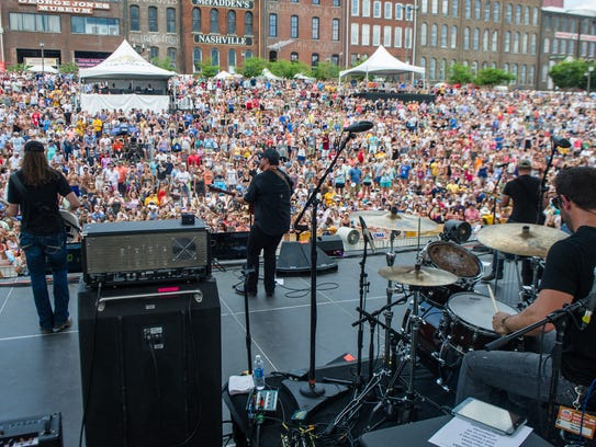 Luke Combs performs on the Riverfront Stage on Sunday,