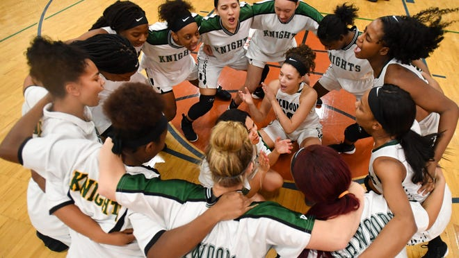 The Richwoods girls basketball team huddles before the tip of their game with Manual in the Class 3A regional semifinal game.