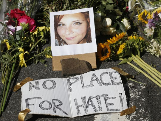 A makeshift memorial of flowers and a photo of victim