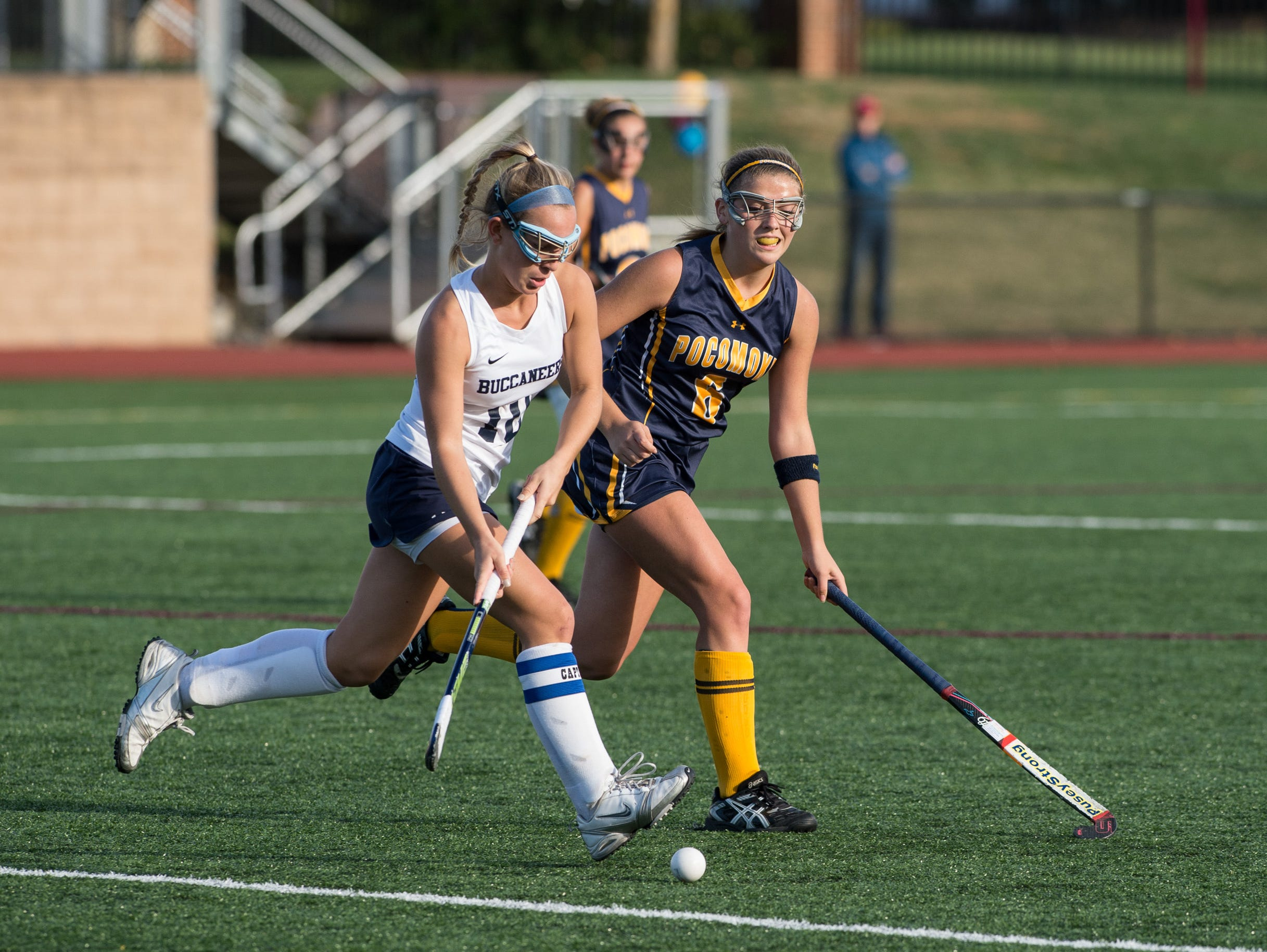 Pocomoke's Kasey Lee attempts to steal the ball against Kent Island's Payton Beach.