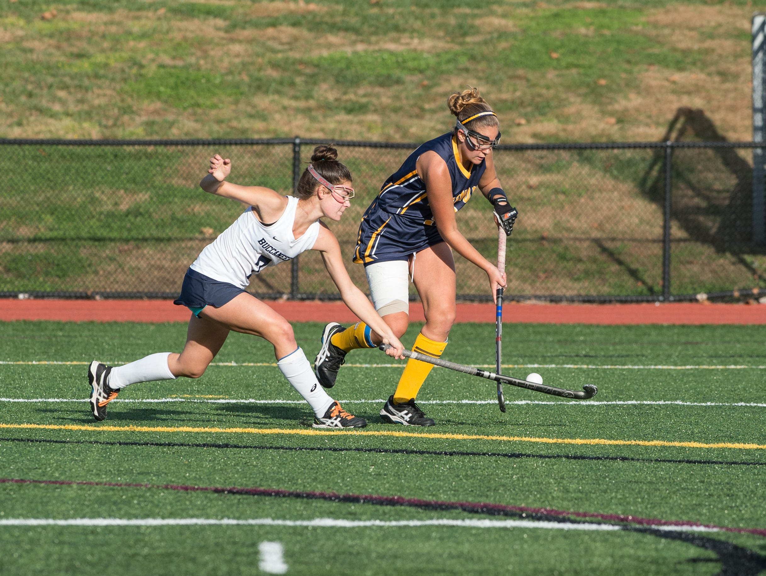 Pocomoke's Dani Batze moves the ball around Kent Island's Nina Cifollili.