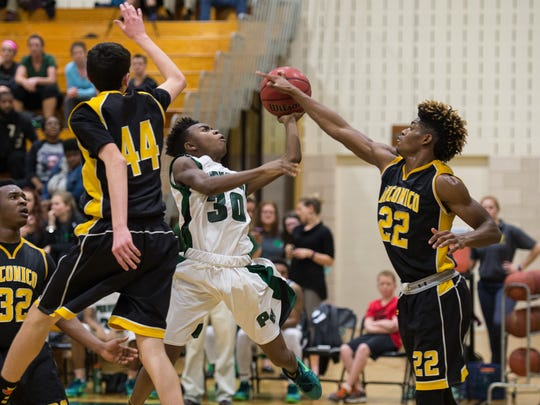 Parkside's Paul Morgan (30) takes a shot on net during a game against Wicomico High School on Thursday, Feb. 4, 2016.