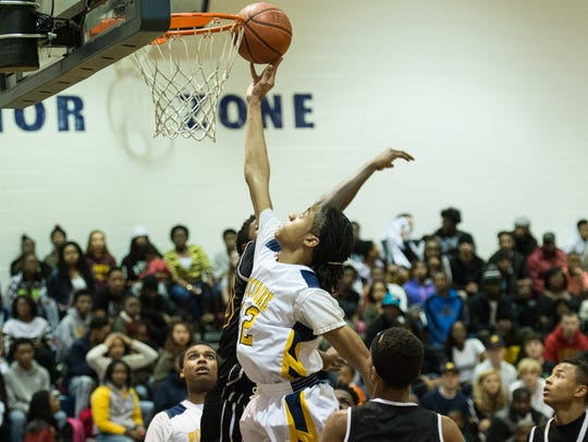 Pocomoke's Jerrick Johnson (32) takes a shot on net
