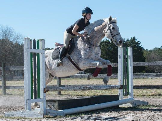 Maggie Garvey, 22, of Kent Island rides her horse,