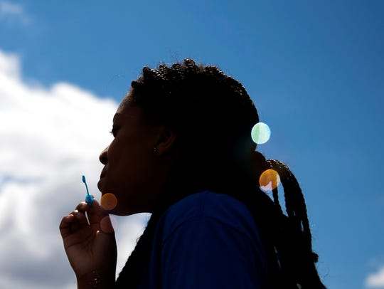 A students blows bubbles as Winslow Elementary hosts