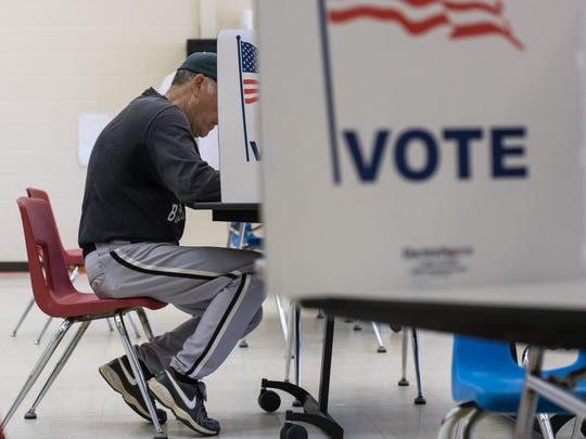 A man votes during the Maryland primary at Parkside