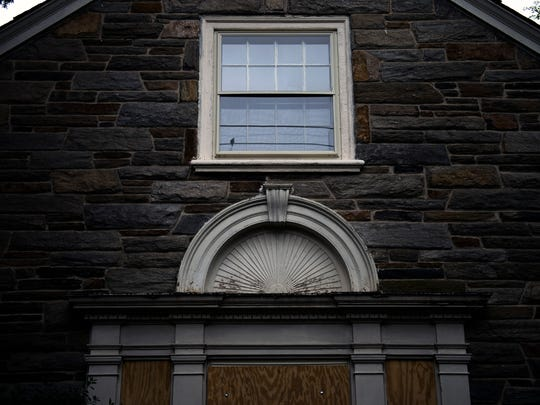 A bird is reflected in a side window of the Snell house