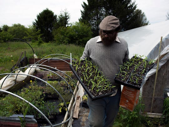 Nate Kleinman of The Experimental Farm Network holds