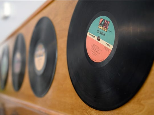 Vinly records left from the old Bus Stop Cafe line the walls of the Human Village Brewing Co. in Pitman. The owners plan to embrace the room's musical past.