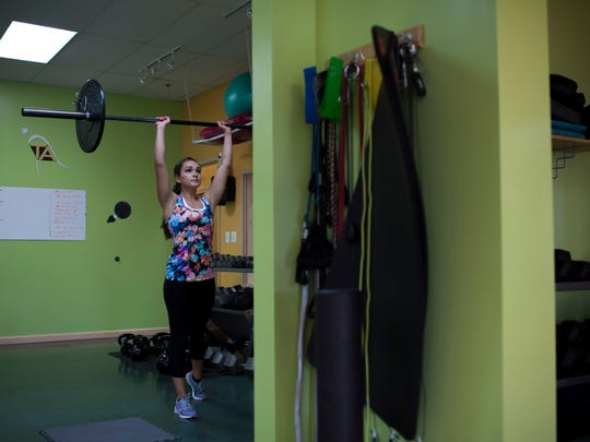 Newly crowned Miss New Jersey Brenna Weick lifts weights as part of her workout at Training Aspects Tuesday in Voorhees.