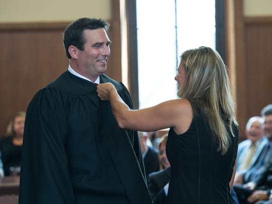 Sarah Maciarello, performs the robing of the judge