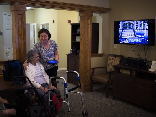 Resident program coordinator Kathy Graham, right, laughs with Rose Anna Miller, 79, as part of a social technology class Wednesday at Brookdale Senior Living in Deptford.