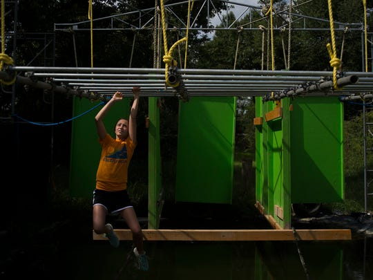 Gracie Horton, 12, tests an obstacle at the site of Goliathon at the Gloucester County Fairgrounds.