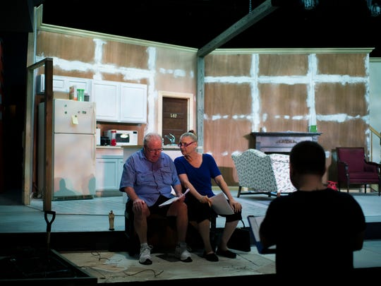 Tom McCarthy, left, rehearses with April Woodall in a scene from The King of East Jabip Tuesday, Aug. 23 at the Eagle Theatre in Hammonton.