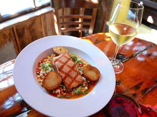 The Back Porch CafŽe located in Rehoboth, features a grilled king salmon braised with sweet corn, chile, cilantro, feta and lime, alongside roasted red potato on their lunch menu.