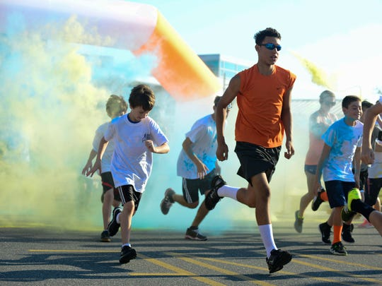 Members of the Pocomoke High School and community joined together on Saturday, Sept. 24, 2016 to join together for the Susan Pusey memorial homecoming color run.