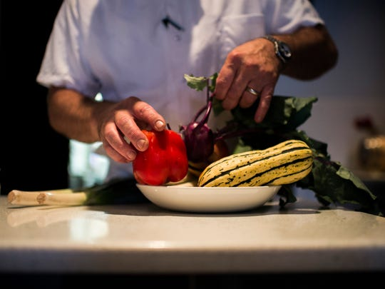 Chef and owner Todd Fuller organizes a bowl of fresh