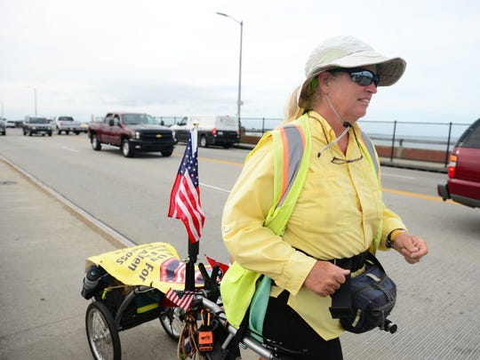 Jan Walker crosses the Rt. 50 bridge on her final leg of her  7-month trek across the United States. Walker started her 2,700 mile journey in Oceanside, California on March 1st and finished in Ocean City on Saturday, Oct. 8, 2016. The goal of WalkerÕs journey from ocean to ocean is to raise money to create a trail to connect all three crash sites from the September 11th attacks.