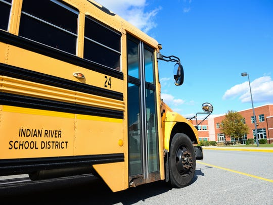An Indian River School district bus sits outside of