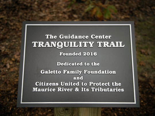 A commemorative sign at the beginning of the Tranquility Trail at The Guidance Center in Millville.