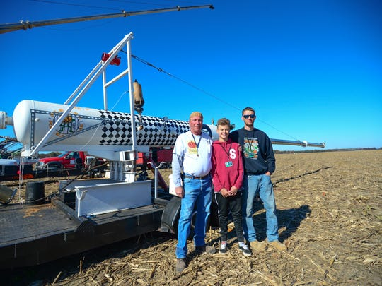 Dominick Daffier and his two grandsons Bryan Miller, 13, and Will Schell, 21 have followed in their grandfathers footsteps and they all compete side by during the 2016 World Championship Punkin Chunkin on Saturday, Nov. 5, 2016.