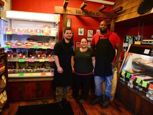 Bryan Hickman along with his sister Jennifer and her husband Brian Tatum stand in their Rehoboth Beach store on Nov. 17, 2016.