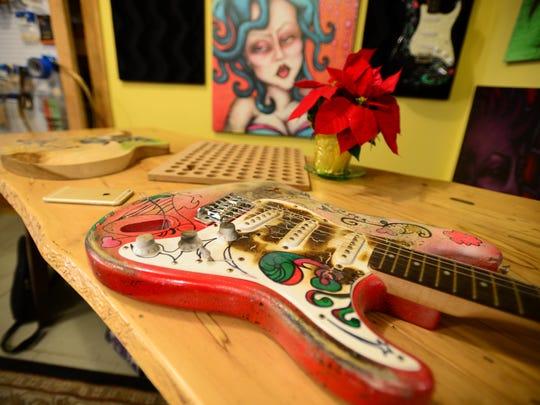 A custom guitar by Nicholas Lee in his custom shop located in Lewes on Friday, Dec. 2 2016.