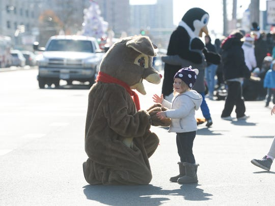 Reese Baker, 2, talks to Trimpers Raindeer during the