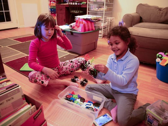 Ava Vidovich, 8, plays with her sister Grace Hicks,