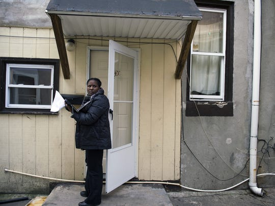 Inspector Toy Humes knocks on the door of a vacated rental property in Camden's Parkside neighborhood.