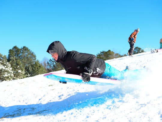 Zoey Hargrove catches some air sledding on Nature Park