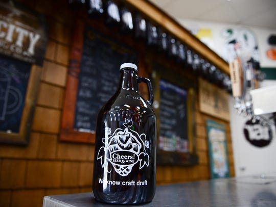 A beer growler sites on a bar in Salisbury, Maryland.