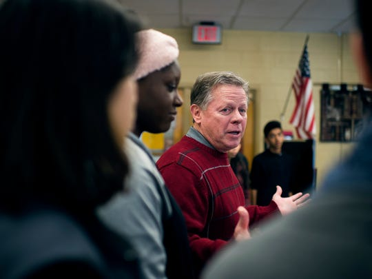 Principal Thomas McCann speaks with past and future student travelers Friday, Jan. 6 inside the school's library in Vineland.