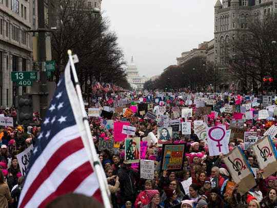 Thousands of marchers walk down Pennsylvania Ave in