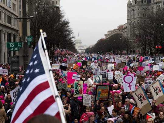 Thousands of marchers walk down Pennsylvania Ave in protest of newly elected president Donald J. Trump Saturday, Jan. 21 in Washington, D.C. (Via OlyDrop)