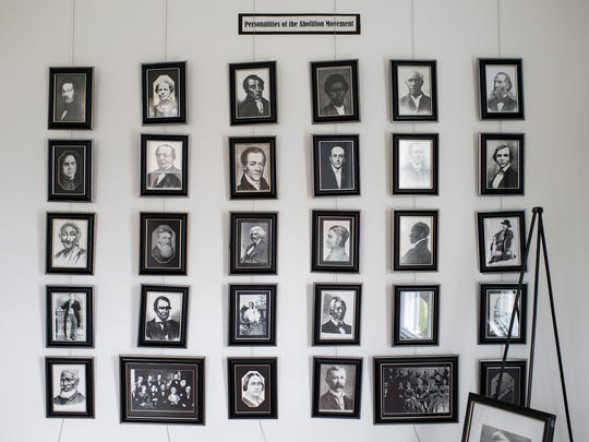 Framed pictures of those involved in the Abolition Movement are displayed inside the Underground Railroad Museum in Eastampton.