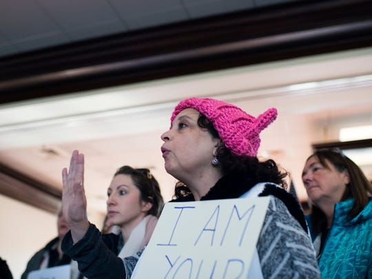 Isabel Abrev of Marlton disputes claims of 'paid protesters' by Congressman Tom MacArthur, R-NJ, as protesters gather in his office Friday in Marlton.