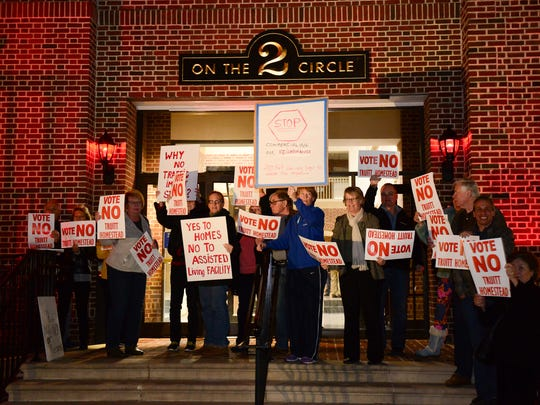 Members of the community gather Monday, Feb. 20 in Georgetown to protest the passing of a special use exception on the James Truitt Farm LLC for an assisted living facility.