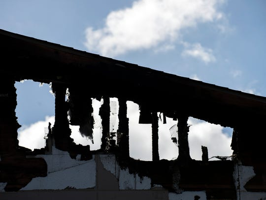 The remains of a fire at a Ramada Inn Friday, Feb.