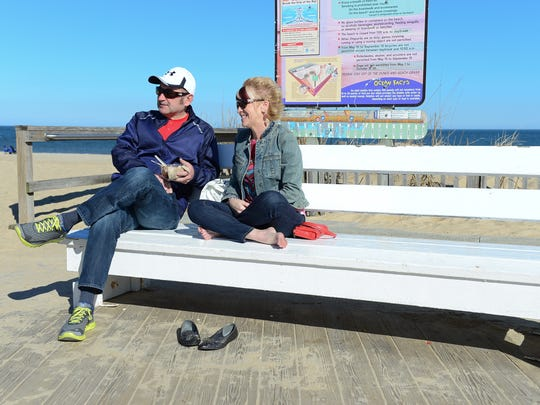 Fred Henise, 56, and Regina Henise, 54, share a Kilwin's ice cream on the Rehoboth Beach boardwalk on Presidents Day. The York, Pennsylvania couple has been vacationing in Rehoboth Beach for 37 years.
