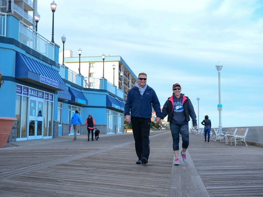 Greg and Claudia Gausepohl, Ocean City, Md. walk on the boardwalk during the off season on Wednesday, March 8, 2017.