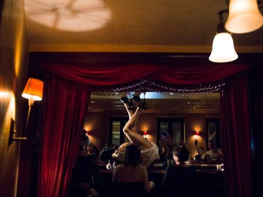 Dito van Reigersberg maneuvers atop the bar as he performs his Martha Graham Cracker Cabaret drag show Thursday, March 9 at L'Etage in Philadelphia.