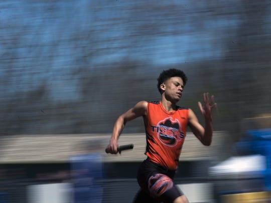 Woodrow Wilson's Tyjuan Henry competes in a 4x400 meter relay during the Moorestown Invitational track meet on Saturday.