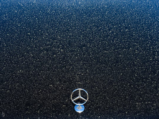 Pollen covers car windows in Bethany Beach on Monday,