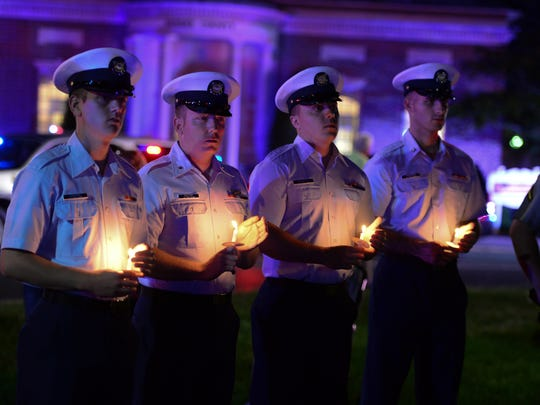 A candle vigil was held in honor of fallen Delaware