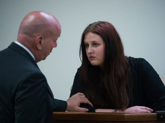 Julia Stensky, right, consults with her attorney as she testifies at the murder trial of her former boyfriend, David 'D.J.' Creato, last week.